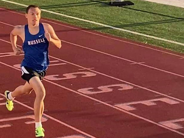 Russell High School sophomore Marcus Koetkemeyer running in Thursday's Russell Invitational at Shaffer Field.