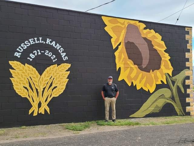 Advantage Realty Mural with Artist GJ Long