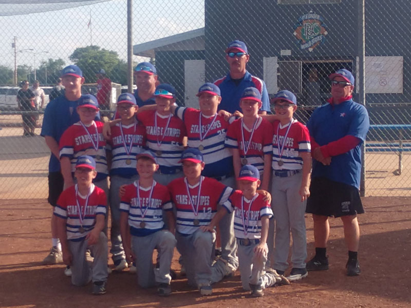 The Stars and Stripes Baseball team from Hays poses with their Gold medals after capturing the Russell Rangers Tournament on Saturday, June 26, 2021 at Memorial Park in Russell.