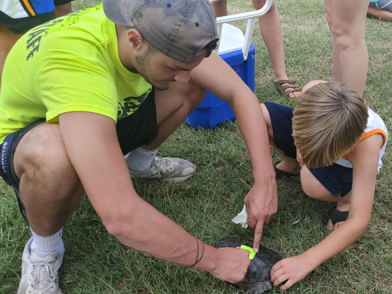 Getting ready for the Turtle and Frog Races on Tuesday, July 20 at the Russell County Free Fair.
