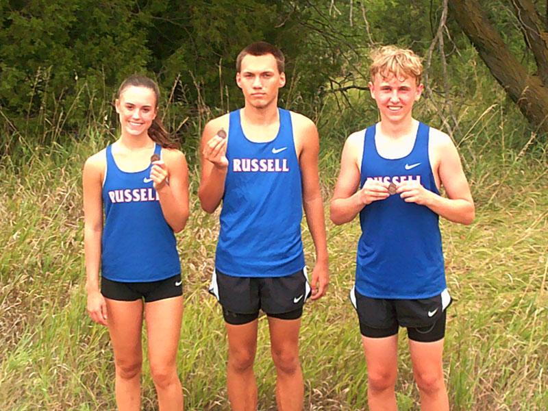 L to R: RHS runners Camille Dortland, Marcus Koetkemeyer and Tyler Lampert at the Hoisington Invitational on Thursday, Sept. 2.