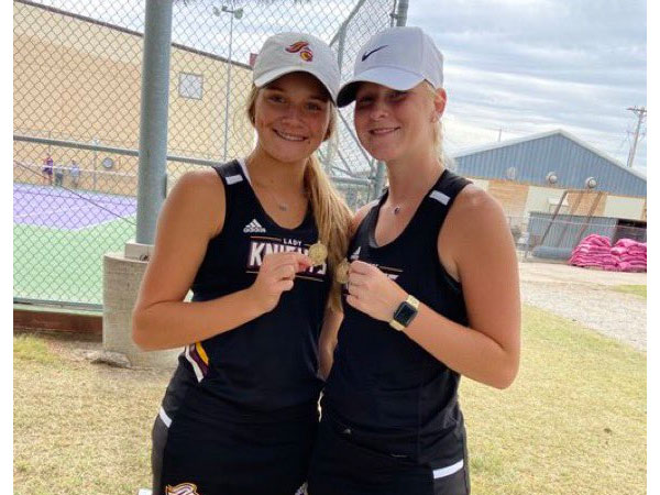 Victoria's Macy Hammerschmidt and MaKenna Wellbrock will play in doubles at the Class 3-2-1A State Tennis Meet on Oct. 15-16 in Maize. (Photo courtesy USD 432 Twitter Page)
